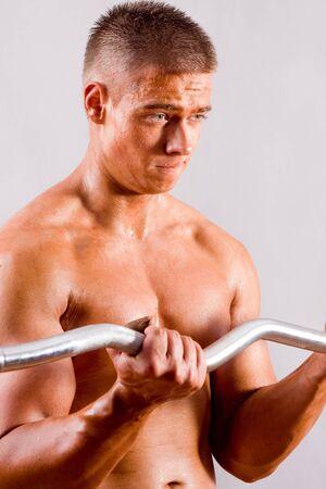 beginner Bodybuilder training in a gym Stock Photo - 12200434