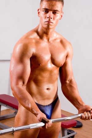 beginner Bodybuilder training in a gym photo
