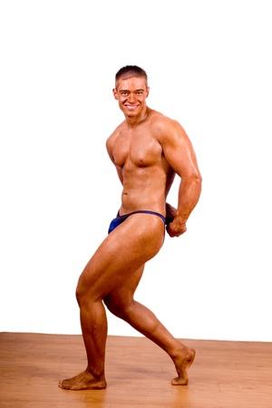 beginner Bodybuilder posing over white background photo