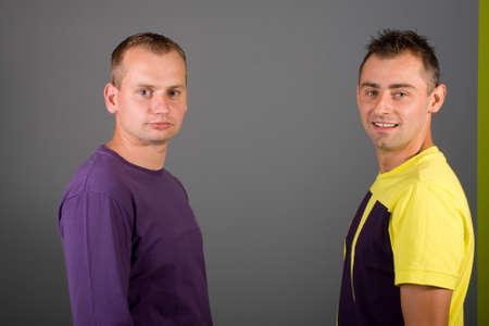 gay men: two attractive guy posing together Stock Photo