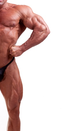 bodybuilder flexing his muscles isolated on white   Stock Photo