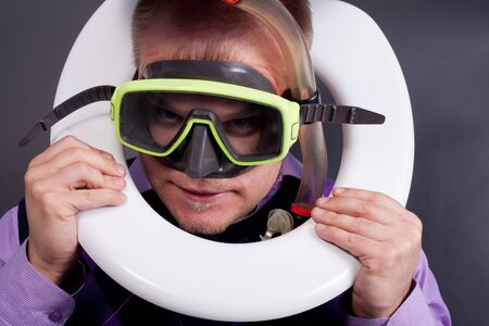 unfortunate: young handsome diver in  toilet Stock Photo
