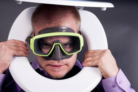young handsome diver in  toilet photo