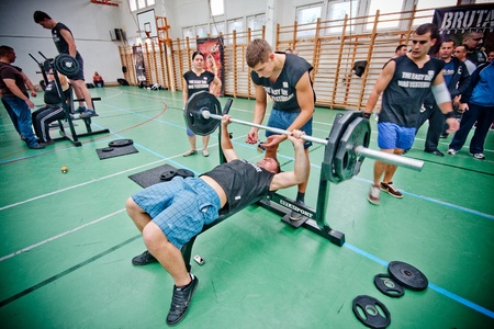 barbel: PECS - OCTOBER 16: Unknown man participates in Brutal Challenge power lifting championship October 16, 2010 in Pecs, Hungacry.