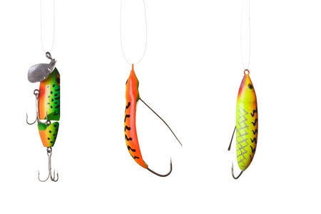 entrap: fishing lures -floating wobblers hanging in front of white background