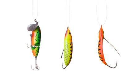allurement: fishing lures -floating wobblers hanging in front of white background