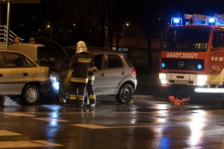 PECS, HUNGARY - DEC. 01: car crashed. Firefighter try to help the victim of car accident on Dec. 01, 2011 on Road 6 in Pecs, Hungary.