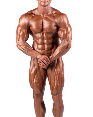 culturista: bodybuilder flexionando sus m�sculos en el estudio Foto de archivo
