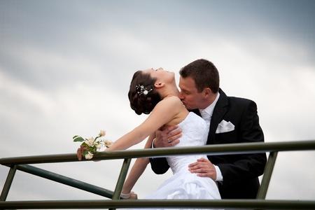 beautiful young wedding couple outdoor photo