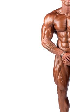 bodybuilder: bodybuilder flexing his muscles in studio Stock Photo