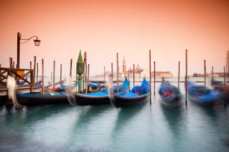 beautiful Venice, Italy with gondolas -colored photo, with added vignetting, long exposure photo