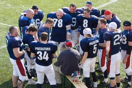the national team: KOZARMISLENY - APRIL 4: Zala Predators (blue) and Pecs Gringos (white) american football teams participate in Hungarian Championship, April 4, 2009 in Kozarmisleny, Hungary.