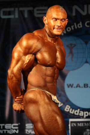 BUDAPEST - JUNE 18:Kokeny Bela participates in WABBA bodybuilding world championship Man Short category on June 18, 2011 in Budapest, Hungary