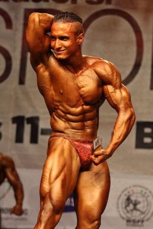 BUDAORS, HUNGARY - JUNE 11: Obertol David participates in WBPF bodybuilding European championship -70kg category on June 11, 2011 in Budaors, Hungary Stock Photo - 13686520
