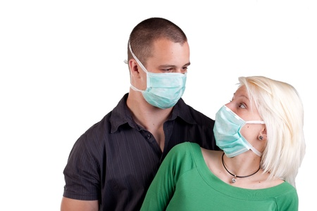 swine flu: young people wearing flu masks over white Stock Photo