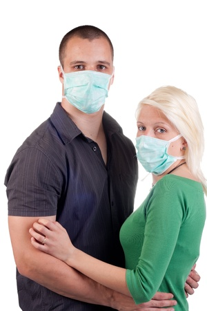 young people wearing flu masks over white photo