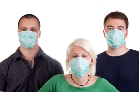 young people wearing flu masks over white Stock Photo - 13765523