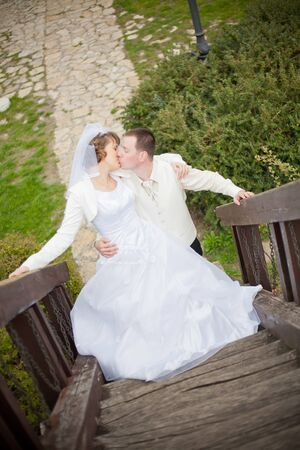 young beautiful wedding couple outdoor photo