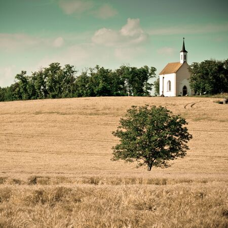 country church: Small chapel with a meadow -colorized photo