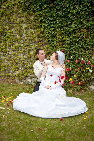 beautiful young wedding couple outdoor photo