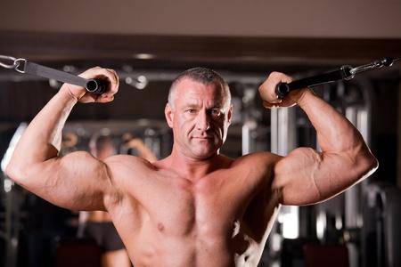 barbel: bodybuilder training in a gym
