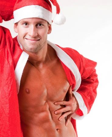 sexy santa: muscular santa claus flexing his muscles