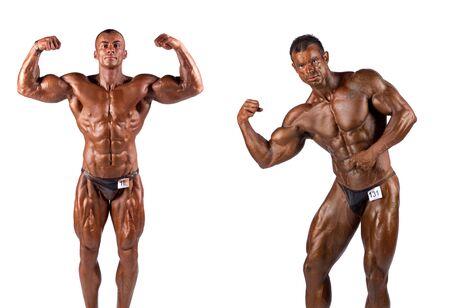 Bodybuilders posing over white background