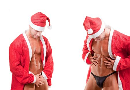bare chest: two muscular santa claus over white