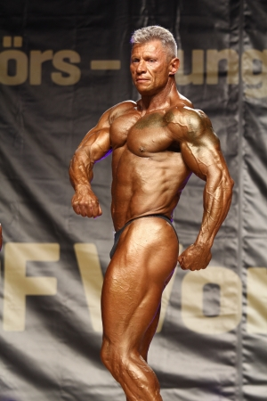 50 yrs: BUDAORS, HUNGARY - JUNE 10: Kovacs Laszlo participates in WBPF bodybuilding World Cup Masters over 50 yrs category on June 10, 2012 in Budaors, Hungary