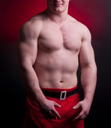 muscular santa claus posing in studio photo