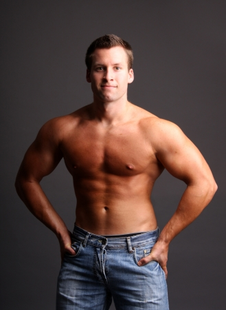 muscular model posing in studio photo
