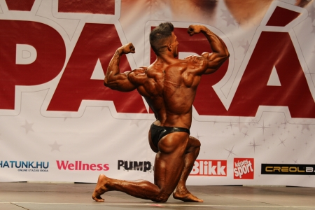 BUDAPEST - OCTOBER 21: Csuhai Janos participates in Fitparade bodybuilding championship Open -80 kg category on October 21, 2012 in Budapest, Hungary