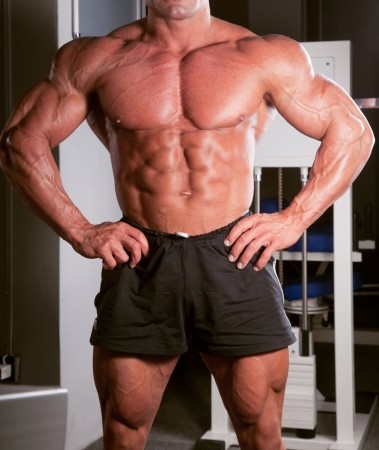 bodybuilder posing in the gym photo