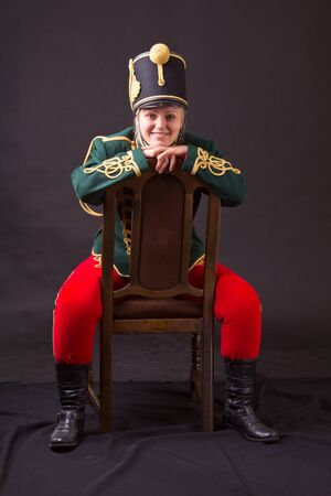 cavalryman: hungarian hussar woman posing in studio Stock Photo