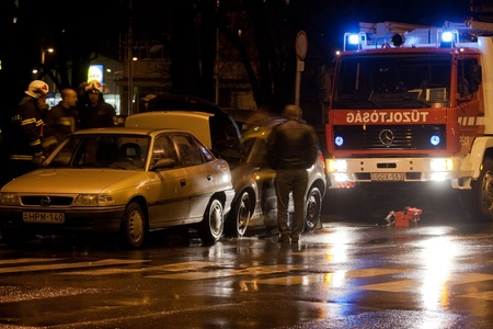 smashup: PECS, HUNGARY - DEC. 01: car crashed. Firefighter try to help the victim of car accident on Dec. 01, 2011 on Road 6 in Pecs, Hungary.