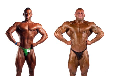 bodybuilders flexing muscles isolated on white