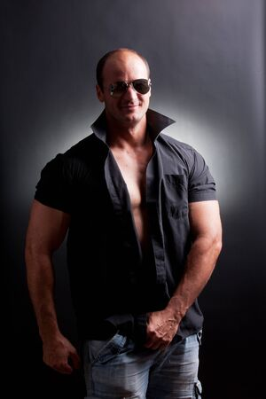 cool mature man posing in studio photo