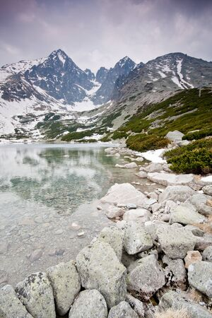 High Tatras with snowy peaks and lake Stock Photo - 17258462