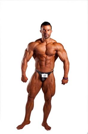 Bodybuilder seine Muskeln spielen im Studio Lizenzfreie Bilder