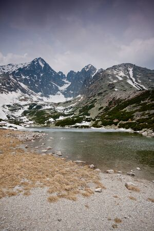 High Tatras with snowy peaks and lake photo