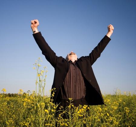 realization: succesfful businessman in rape field Stock Photo