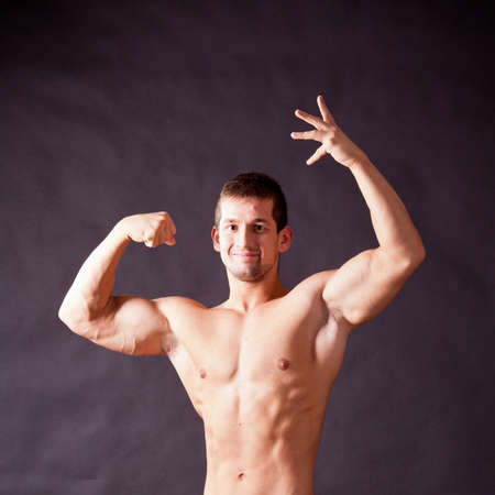young bodybuilder posing in studio Stock Photo - 17447061