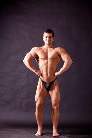young bodybuilder posing in studio Stock Photo - 17447052