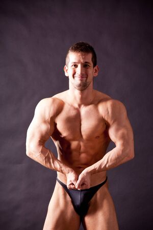 young bodybuilder posing in studio Stock Photo - 17447055