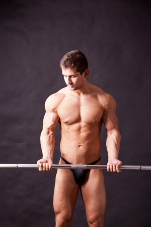 young bodybuilder traininig over balck background Stock Photo - 17447053