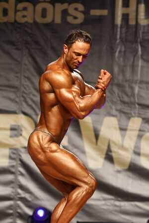 BUDAORS, HUNGARY - JUNE 10: Aleksandr Lalapats participates in WBPF bodybuilding World Cup Athletic Physique +175cm category on June 10, 2012 in Budaors, Hungary Stock Photo - 17838110