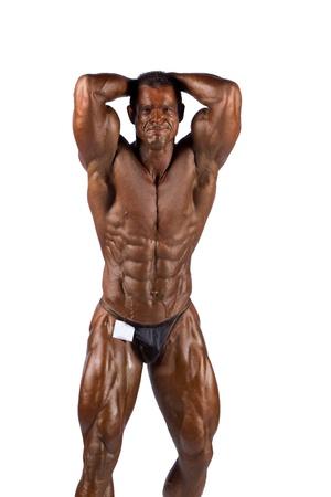 body builder: bodybuilder flexing his muscles in studio Stock Photo