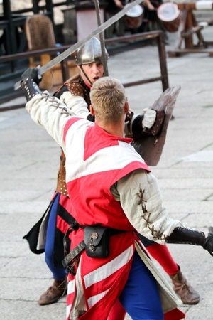 visegrad: VISEGRAD HUNGARY - AUGUST 27: Knights taking part in tournament reconstruction in Visegrad castle on August 27, 2012 in Visegrad, Hungary Editorial