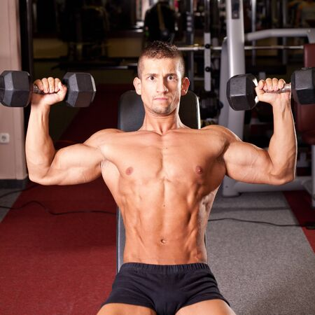 Bodybuilder training in a gym photo