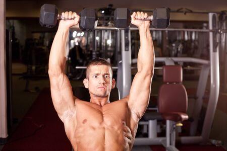 tricep: Bodybuilder training in a gym